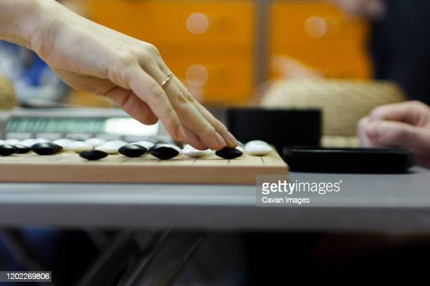 playing the game of go, process game - editorial stock pictures, royalty-free photos & images