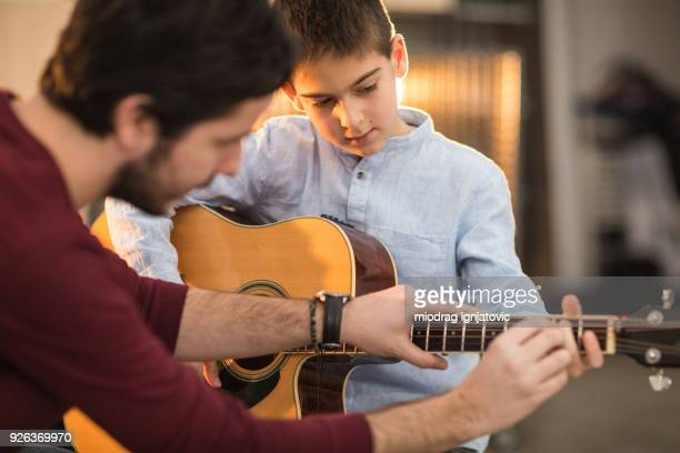 Playing the guitar with my brother