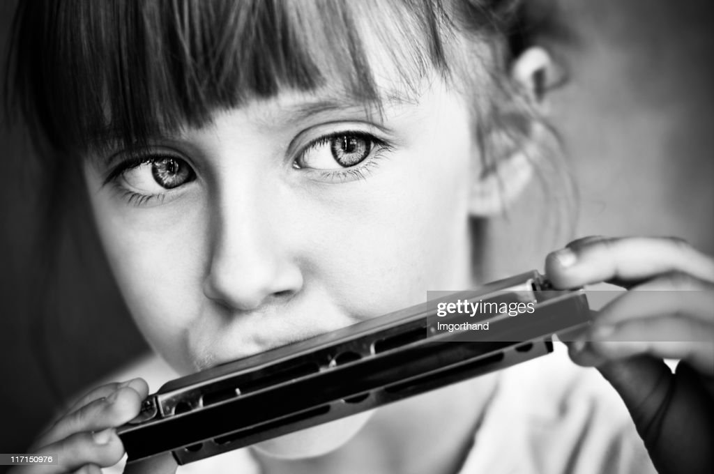 Playing the harmonica : Stock Photo