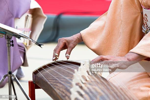 Playing the Koto or Japanese harp