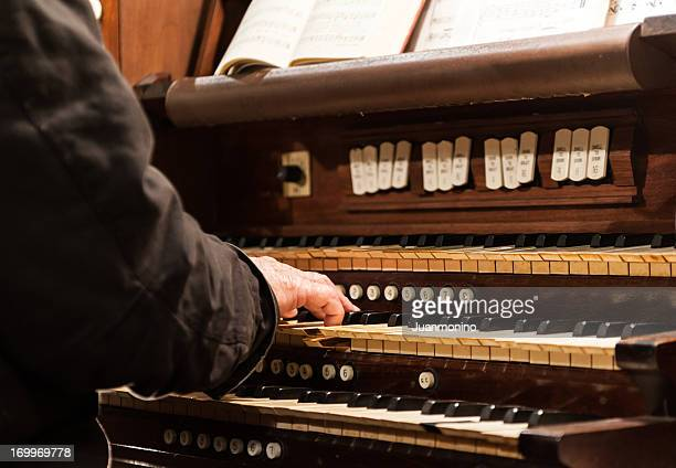playing the organ - church organ stock pictures, royalty-free photos & images