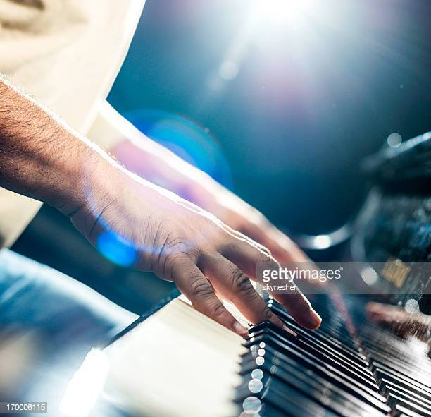 playing the piano. - keyboard player stock photos and pictures