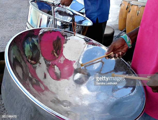 playing the soothing music of steel drums - steel drum stock photos and pictures