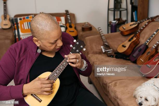 playing the ukelele - disability collection stock pictures, royalty-free photos & images