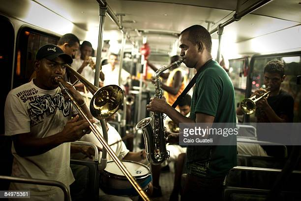 Playing their instruments inside a public bus some local musicians go back home in the end of the first carnival night on February 21 in Salvador...