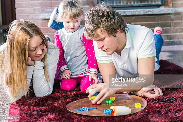 playing together - happy family - pjphoto69 stockfoto's en -beelden