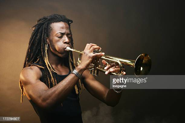 playing trumpet - trumpet stock photos and pictures