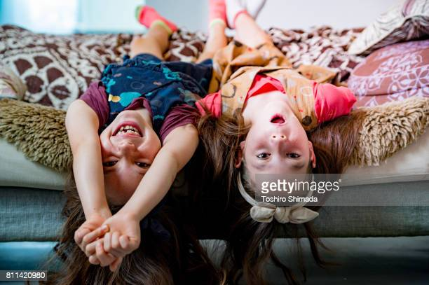 playing twin - asian twins stock photos and pictures