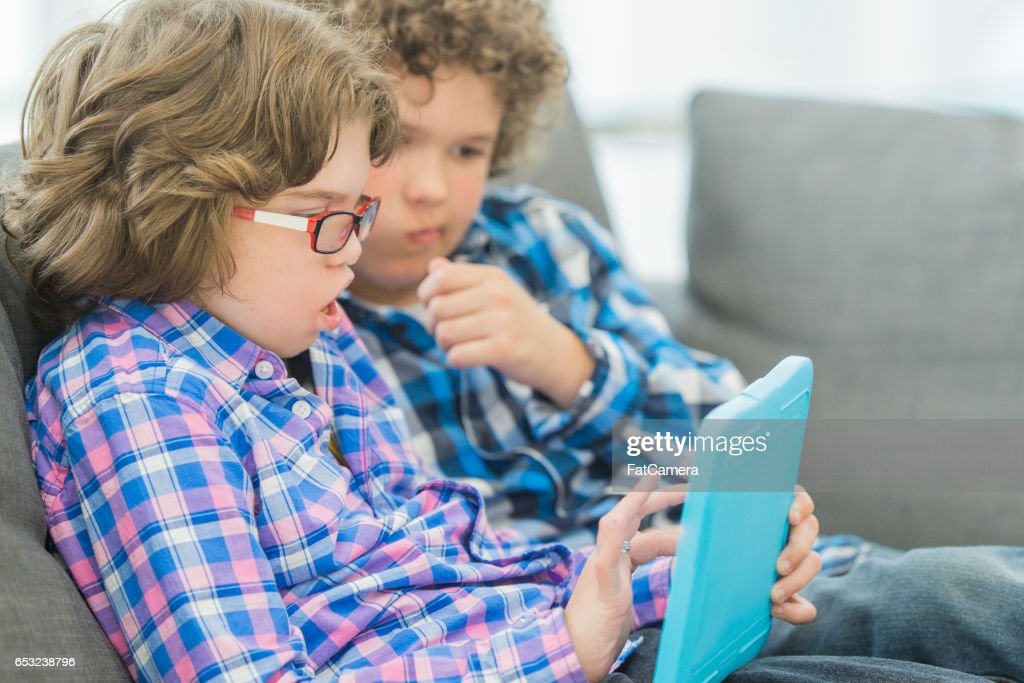 Playing Video Games Together : Stock Photo