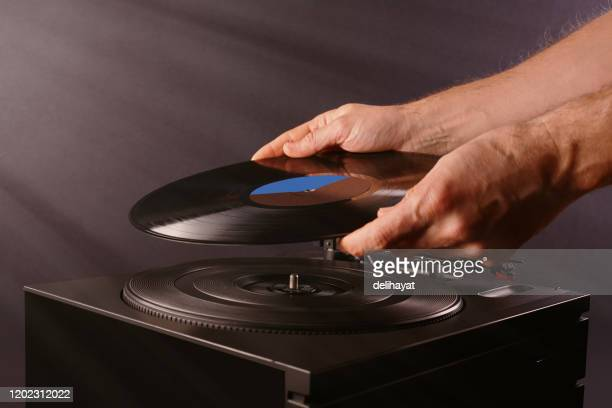 playing vinyl on turntable record player - record analog audio stock pictures, royalty-free photos & images