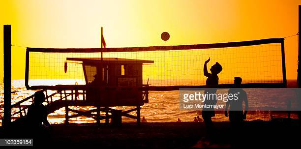 Playing Volleyball at Sunset