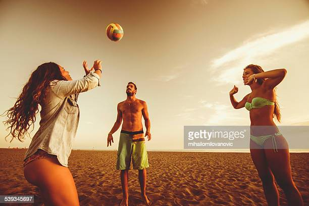 Playing volleyball at the beach