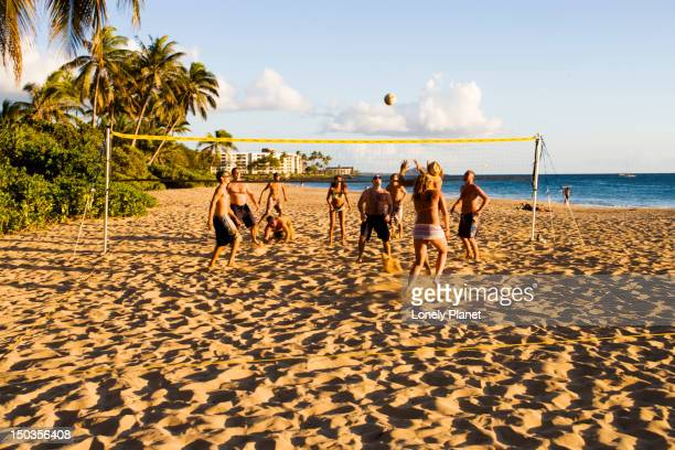 Playing volleyball on Charley Young Beach, Kihei, South Maui.