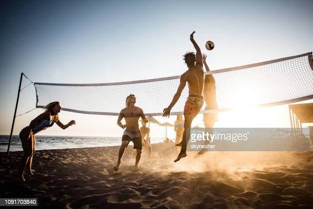 playing volleyball on the beach! - beach volleyball stock pictures, royalty-free photos & images