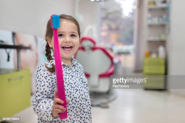 playing with a big toothbrush - dentist stock pictures, royalty-free photos & images