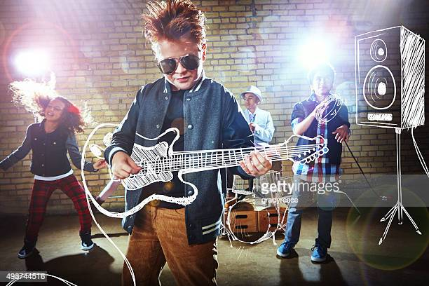playing with a rockstar attitude - stars and strings stock photos and pictures