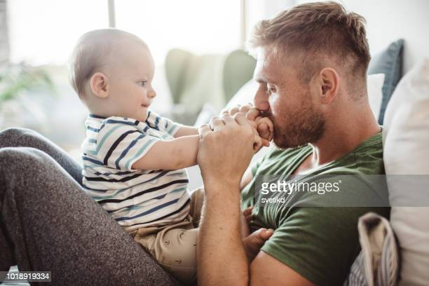 playing with baby boy - single father stock pictures, royalty-free photos & images