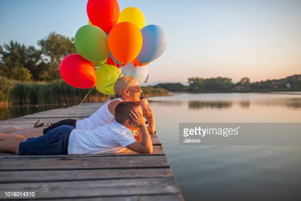 Playing with balloons by the lake