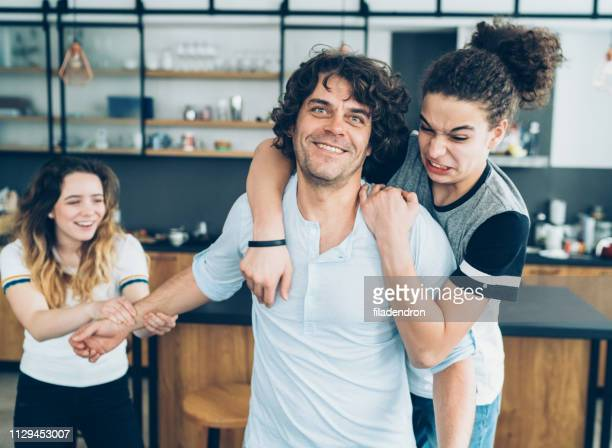 playing with father - girl wrestling stock pictures, royalty-free photos & images