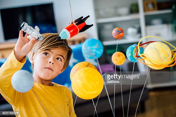 playing with his astronaut - spielen stock-fotos und bilder