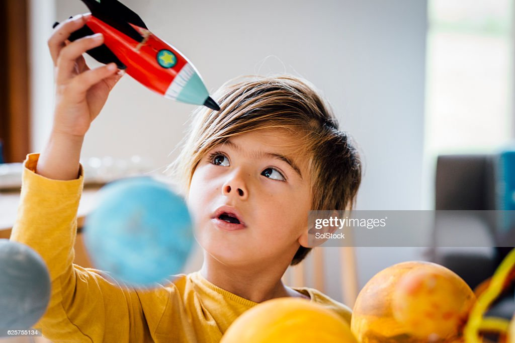 Playing with his Rocket : Stock Photo