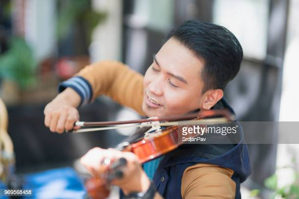 playing with his soul - violin family stock photos and pictures