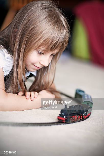 Playing with miniature train
