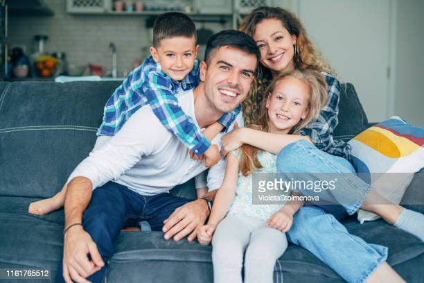 playing with mom and dad - young family stock pictures, royalty-free photos & images