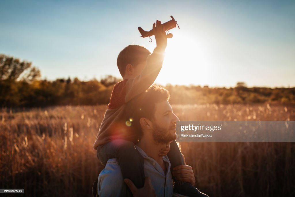 Playing with my dad outside : Stock Photo