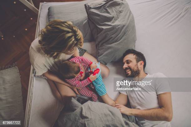 playing with our baby - puppet show stock photos and pictures