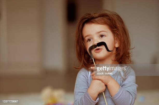 playing with paper mustache - moustache stock pictures, royalty-free photos & images