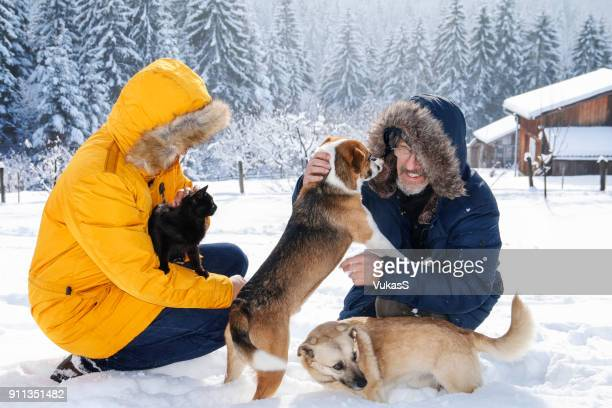 Playing with pets on the snow