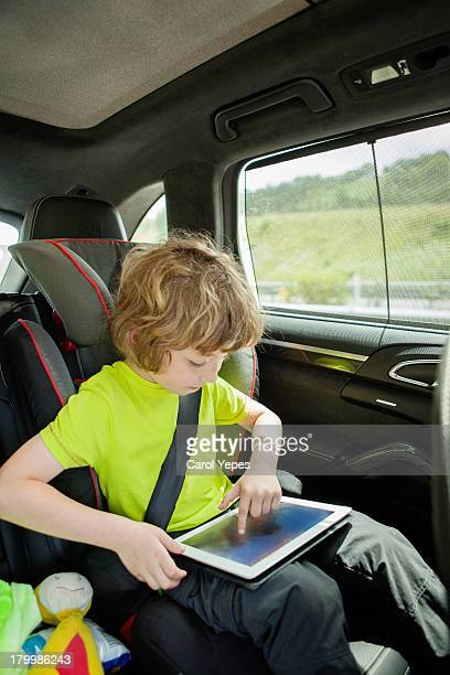 playing with tablet at car