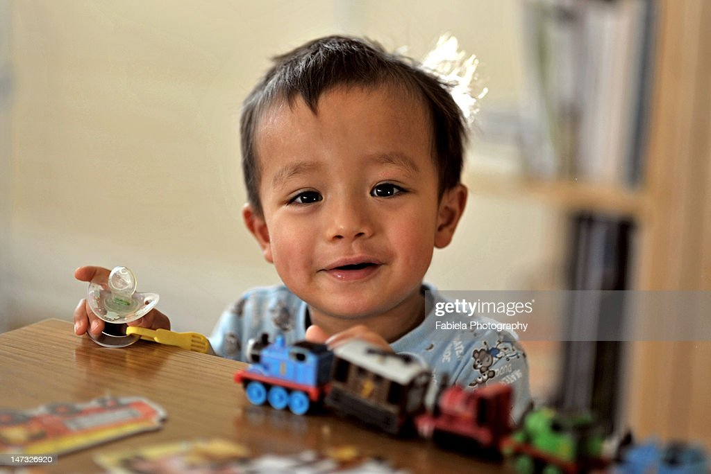 Playing with toy train : Foto de stock