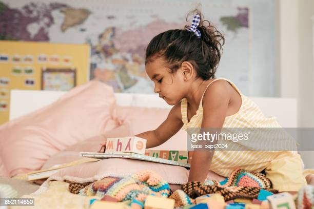 playing with wooden blocks - sri lankan school girls stock photos and pictures