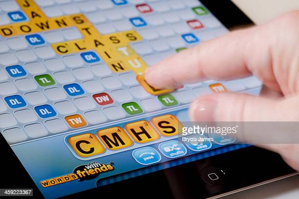 playing words with friends on an ipad horizontal - single word stock pictures, royalty-free photos & images
