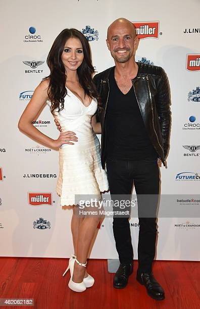 Playmate Antonia Petrova and Peyman Amin attend the Kitz n' Glamour Party 2015 on January 23 2015 in Kitzbuehel Austria