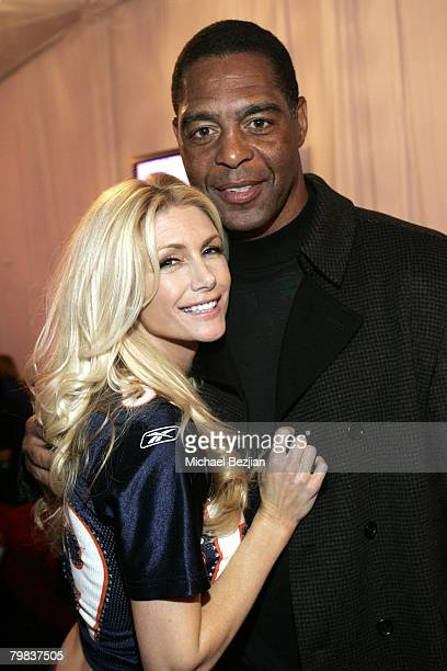 Playmate Brande Roderick and former athlete Marcus Allen pose at the Playboy Mansion Super Bowl Party on February 3 2008 in Los Angeles California