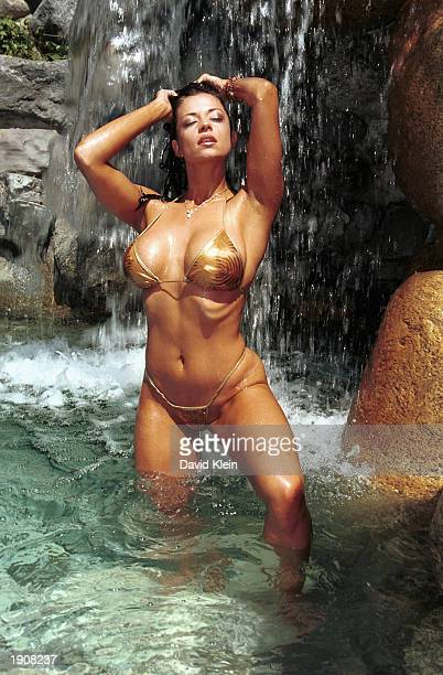 Playmate Candice MIchelle poses in the Playboy pool on April 8 2003 at the Playboy Mansion Beverly Hills California Playboy Magazine launched its...