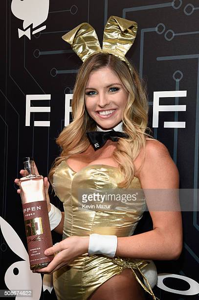 Playmate Carly Lauren wearing a Bunny costume inspired by the gold detailing on EFFEN Vodka's limited edition football bottle arrives at The Playboy...