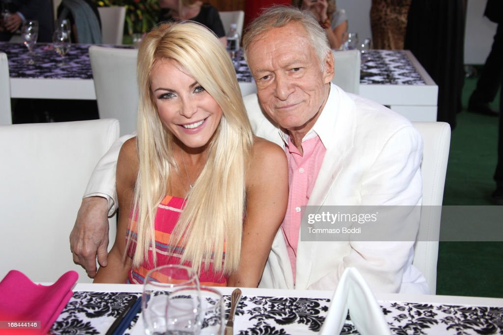 Playmate Crystal Hefner (L) and Founder of Playboy Enterprises Hugh Hefner attend the 2013 Playboy Playmate of the Year announcement and reception held at The Playboy Mansion on May 9, 2013 in Beverly Hills, California.