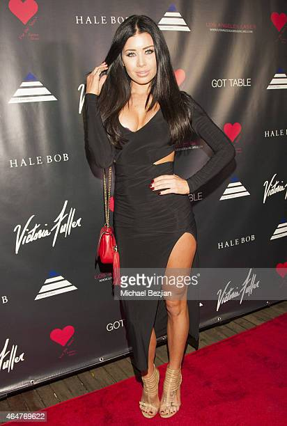 Playmate Gemma Lee Farrell attends Caroline Burt DJs At Victoria Fuller's The Beauty Code Art Show at The Redbury Hotel on February 25 2015 in...