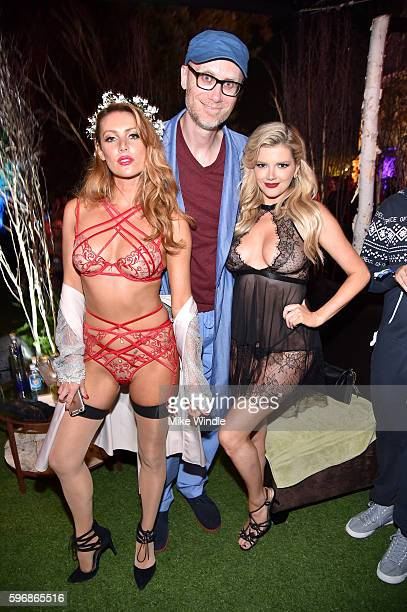 Playmate Gia Marie actor Stephen Merchant and playmate Stephanie Branton attend the annual Midsummer Night's Dream party hosted by Hugh Hefner at The...