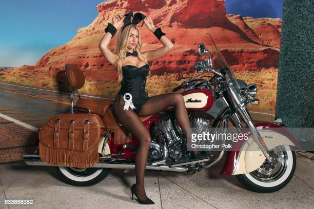 Playmate Heather Rae Young poses on the Indian Motorcycle during the Playboy party with TAO at Spire Nightclub on February 4 2017 in Houston Texas
