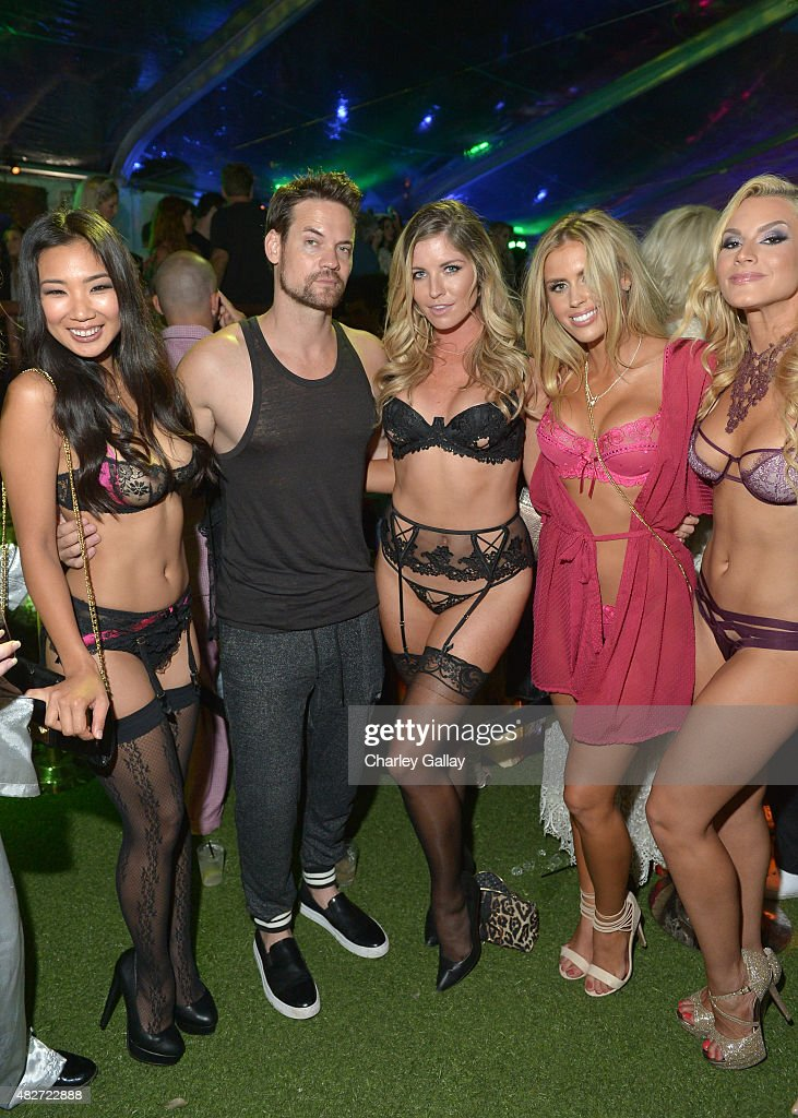 Playmate Hiromi Oshima, actor Shane West, and Playmates Carly Lauren, Kayla Rae Reid, and Shannon James attend the annual Midsummer Night's Dream Party at the Playboy Mansion hosted by Hugh Hefner on August 1, 2015 in Los Angeles, California.
