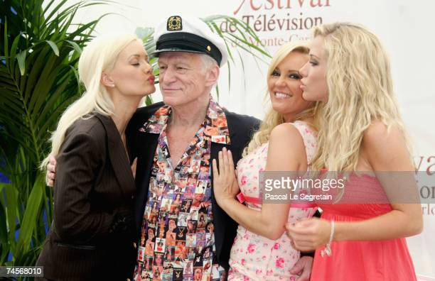 Playmate Holly Madison Hugh Hefner playmates Bridget Marquardt and Kendra Wilkinson attend a photocall promoting the television serie 'Girls Next...