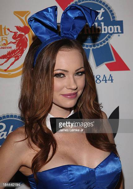 Playmate Kimberly Phillips attends the Snoop Dogg Presents Colt 45 Works Every Time mansion party with Evan and Daren Metropoulos at The Playboy...