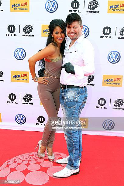 Playmate Mia Gray and Oliver Burghart arrive at 'The Dome 63' music show at the Forum Ludwigsburg on August 29 2012 in Ludwigsburg Germany