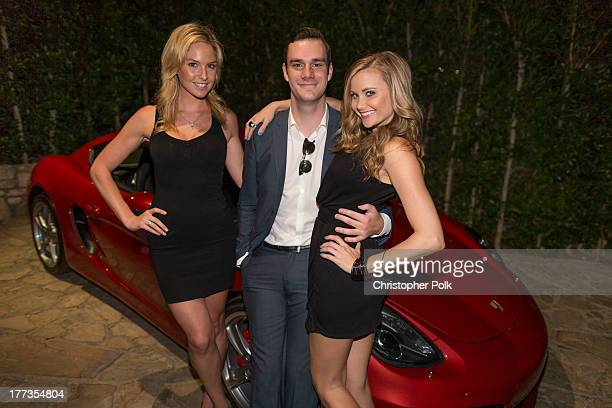 Playmate Michele McLaughlin Cooper Hefner and playmate Kara Monaco at The Playboy Mansion on August 22 2013 in Beverly Hills California