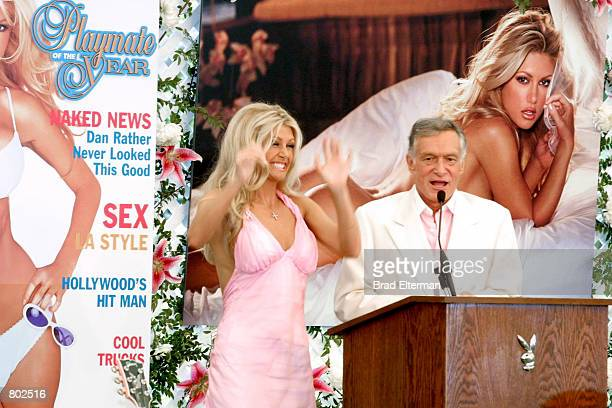 Playmate Of The Year Brande Roderick cheers as Hugh Hefner makes a speech at the Playmate Of The Year Party April 26 2001 in Los Angeles CA